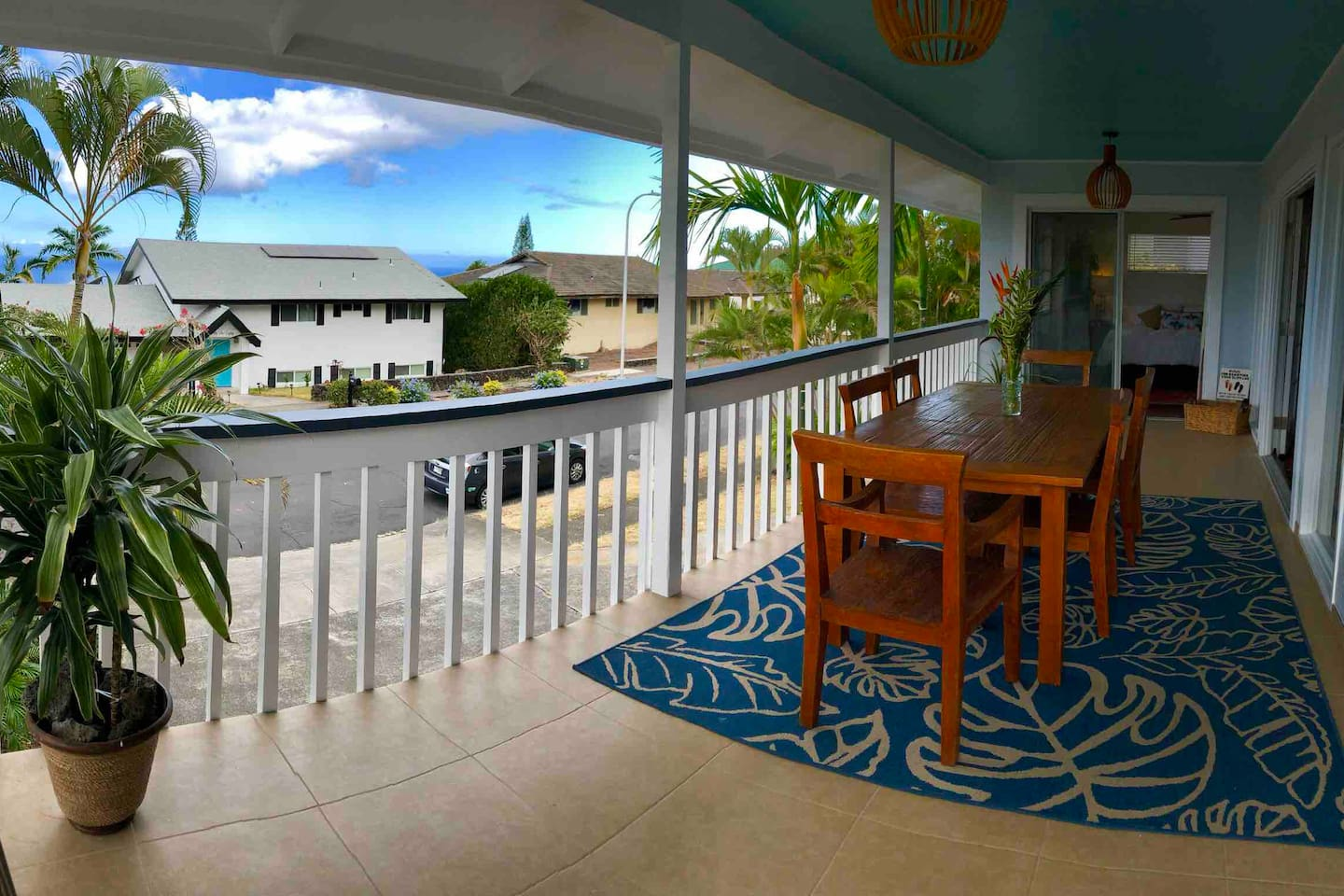 Front lanai with bamboo dining table. Ocean views and perfect Kona sunsets.