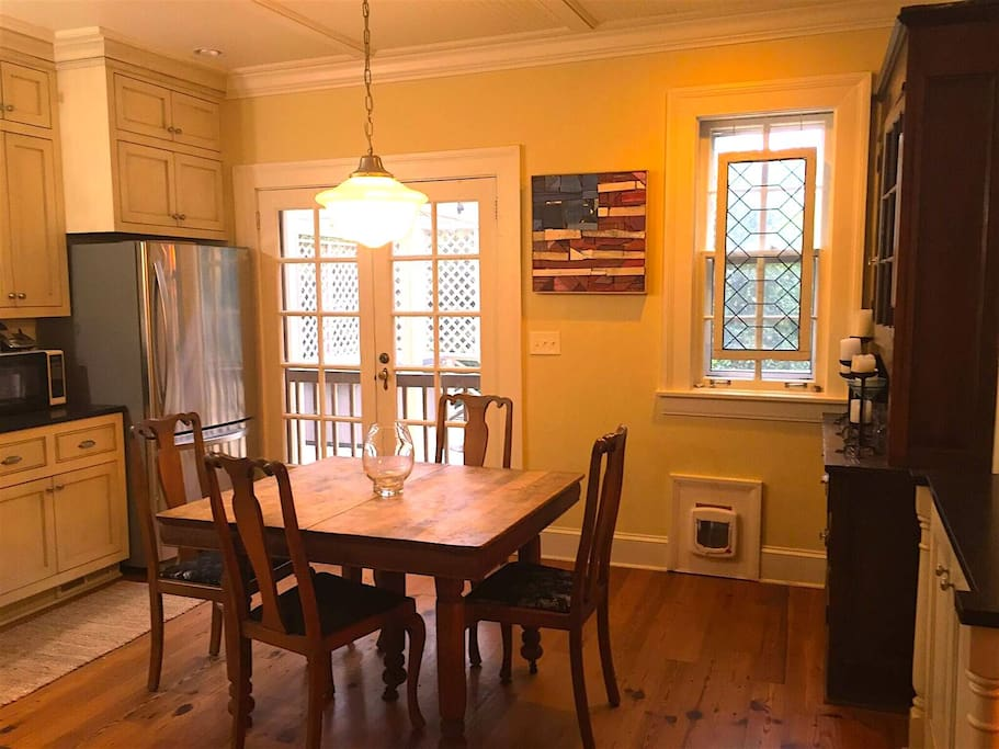 Antique wood kitchen table with black tumbled granite and reclaimed pine floors.  New stainless appliances.  French doors exit to deck.  Note small pet door if your animal wants to roam (otherwise blocked).
