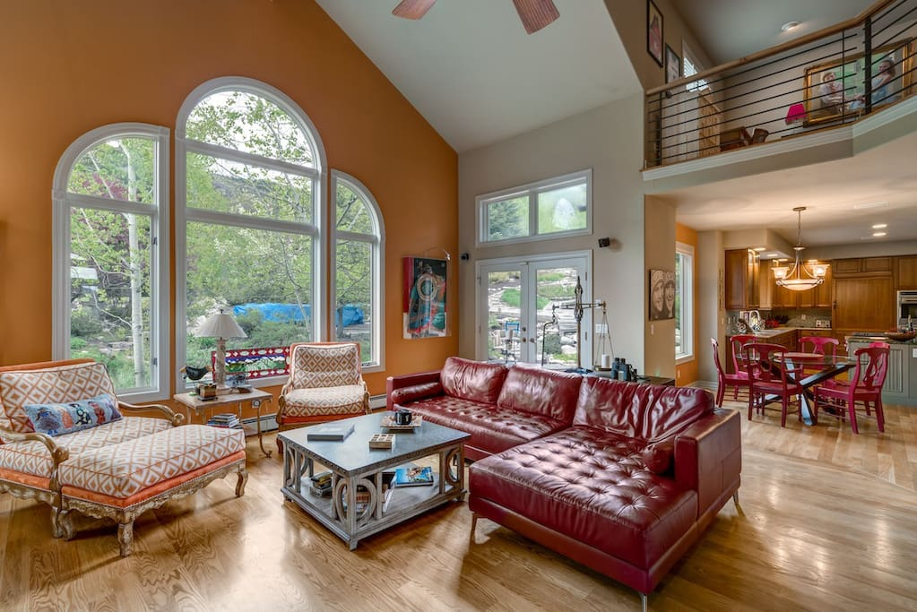 Vaulted ceilings and large windows bring a grand sense of space to the main living room.