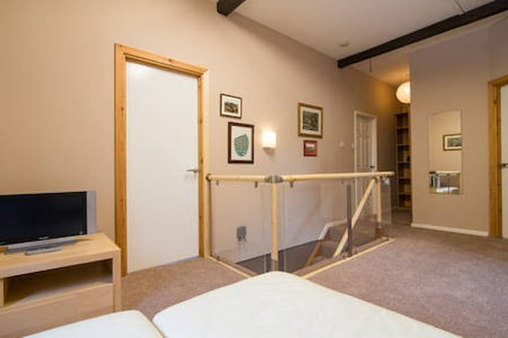 2nd floor landing area, TV, DVD player, L Shaped Settee, great area for the kids to escape the adults!
