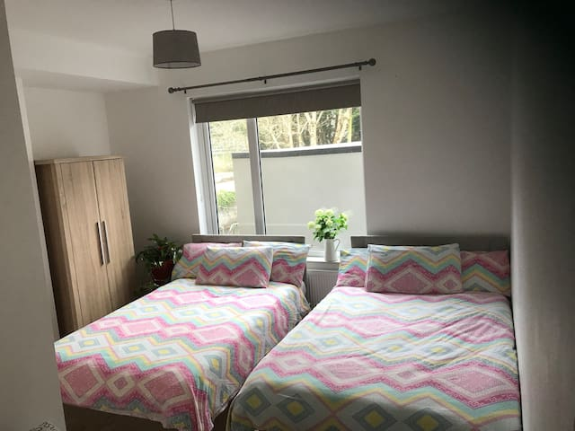 Comfy & close to the city, twin ensuite bedroom.