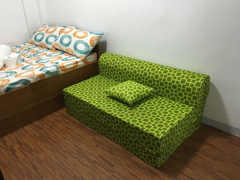 Sofa in green room (folded)
