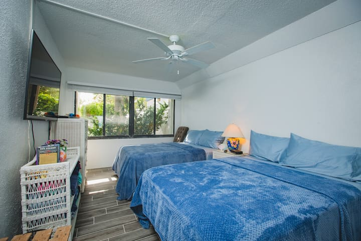 Second bedroom, overlooking a small court yard. Two full size beds. Large Smart TV with plenty of cable channels. High Speed internet for your entertainment!