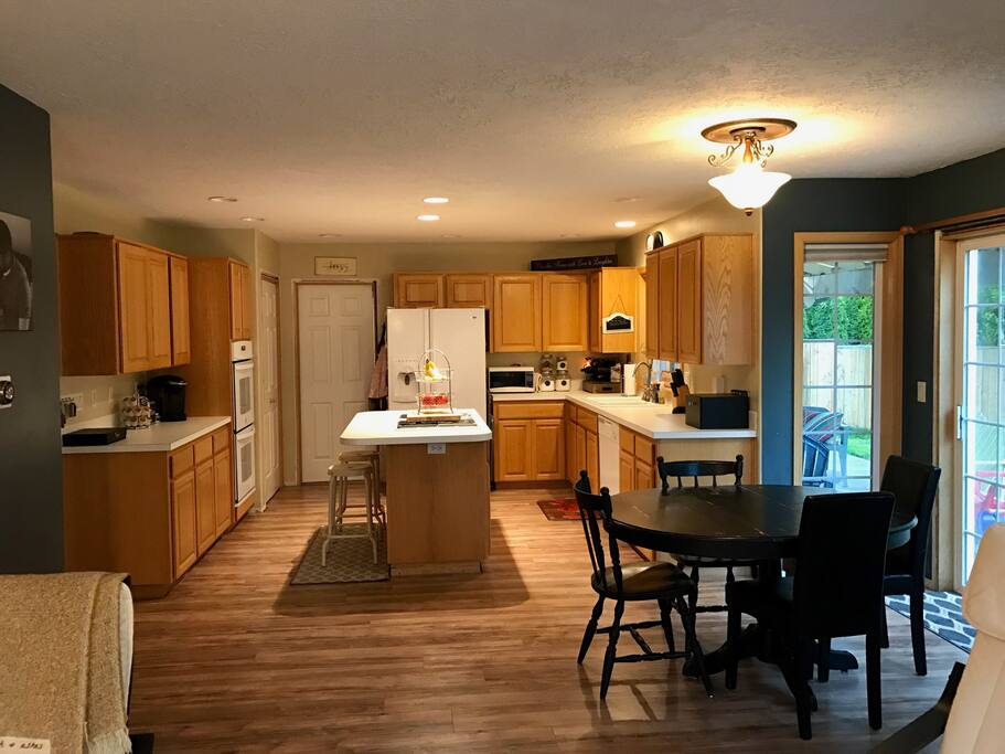 Fully furnished kitchen with double oven.