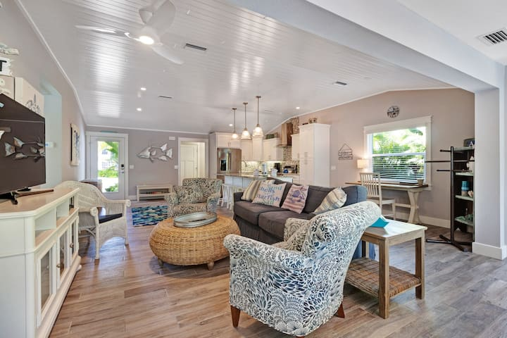 Bright and cheery waterfront home with private pool and spa