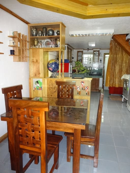 The formal dining room with the kitchen