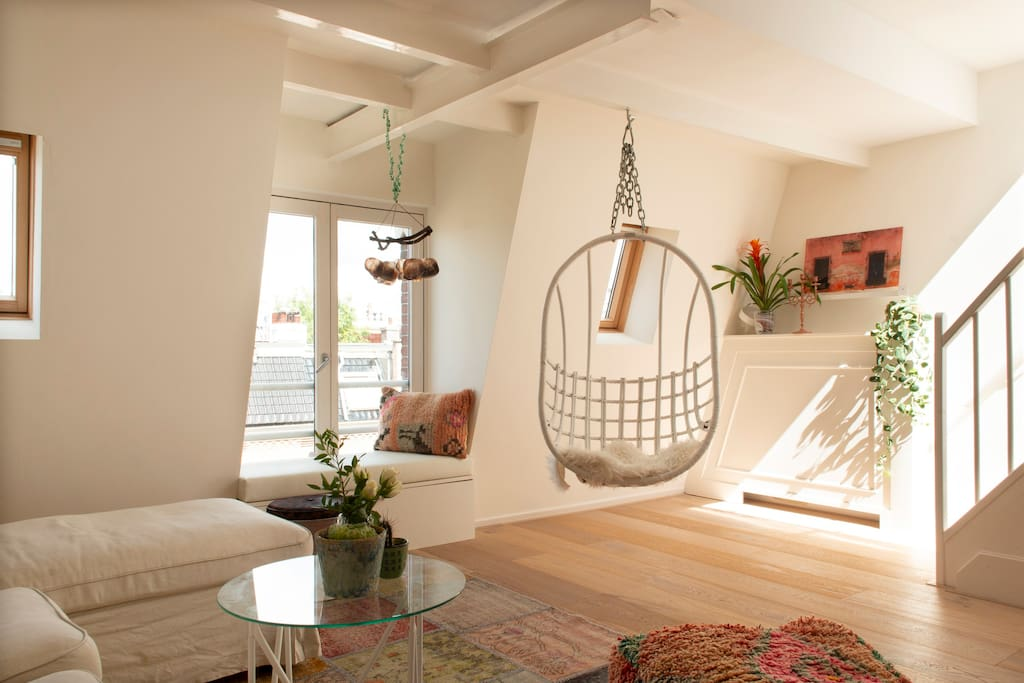 Make your relaxing afternoon even better by watching over the roofs in your swing chair