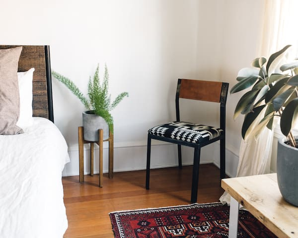 Plant and side chair in the Corner View Bedroom