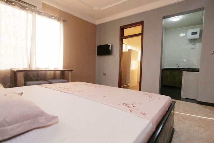 Welcoming rooms and homely feel. Great value accommodation in the heart of East Legon, Accra, Ghana. Your room includes : Shower and W/C AC Kettle Stove Fridge Shared amenities including: iron, washing machine, microwave