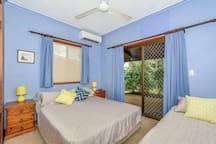 Last bedroom Queen/Single bed. Sliding door to back verandah