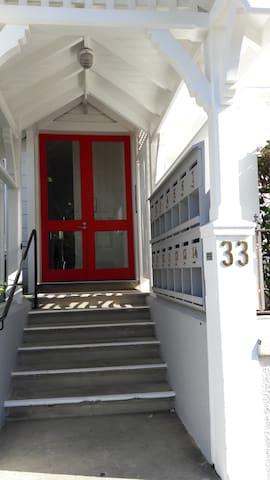 Welcome through the red door