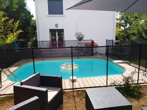 Ground floor independent swimming pool and garden.