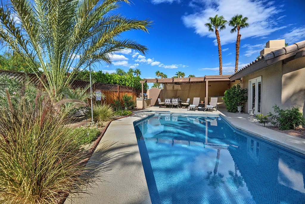 POOL AND SPA TO BACK OF HOUSE NESTLED - PADUA PARADISE - PALM SPRINGS VACATION RENTAL POOL HOME