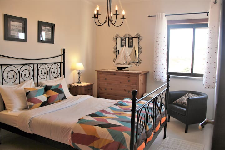 """Two bedroom apartment in front of the ocean, sea view from all windows. This on the Picture is the Bedroom """"One"""" the apartment main bedroom."""