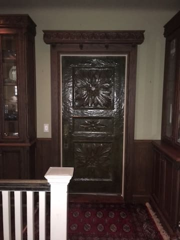 "The entrance to the Penthouse is a carved Honduras Mahogany door that was carved by the famous German  Carver, Alexander ""Chips"" Zeller in 1967.  It is a valuable art piece as are many of the porcelains, antique furniture and paintings."