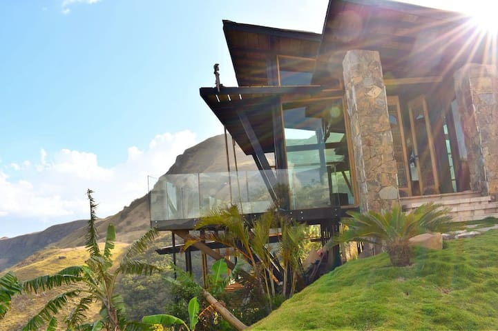 MAGIC GLASS HOUSE IN THE MOUNTAIN