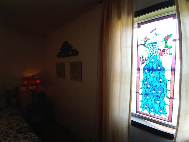 #2 KANSAS DREAMS room with stained glass peacock.