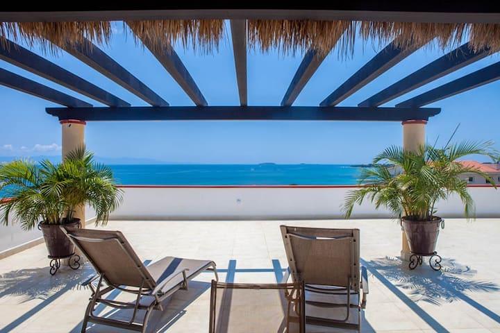 Ocean view, 2 storey penthouse condo. Beach access
