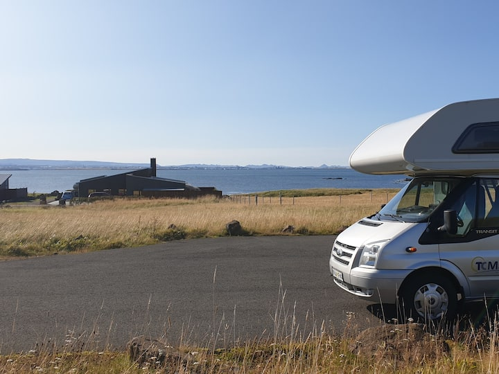 Parked Rv with amazing view to Reykjavik and Esja