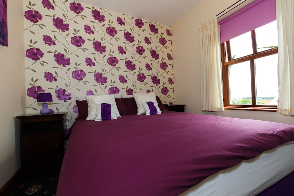 Small comfortable room with large double bed, TV/DVD and tea and coffee making facilities