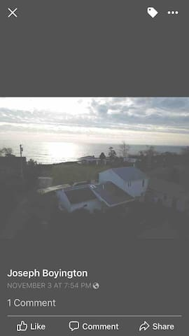 Drone view of the house and it's proximity to the ocean.