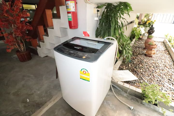 The shared washing machine is located on the 1st floor and it is 24 hrs self-service.
