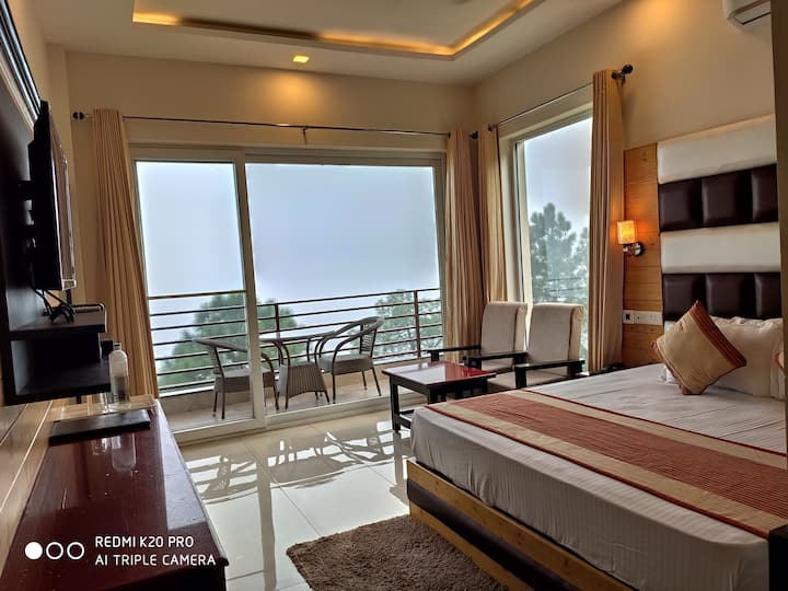 PREMIUM AC ROOM ( Hill View With Pvt. Balcony)