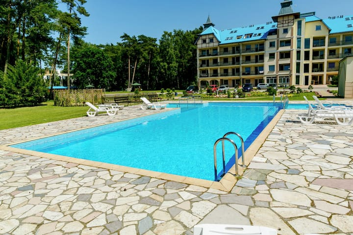 Beautiful apartment by the forest - garden, pool; only 150m from the sea.