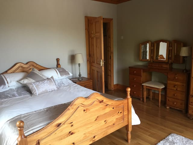 Spacious double bed with dressing table