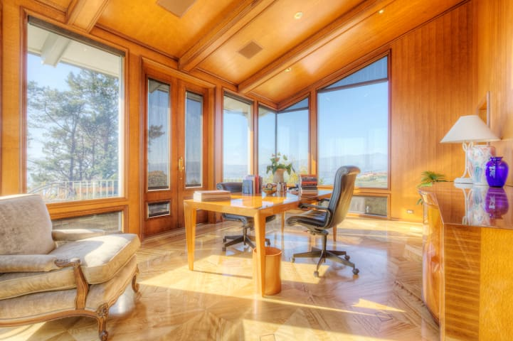 Fourth bedroom/office room trimmed in custom wood. It has a queen sized bed, ensuite bathroom and expansive panoramic views of Richardson bay and the golden gate bridge beyond!