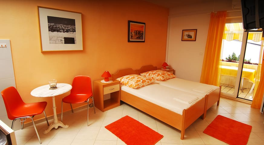 Orange studio apartment