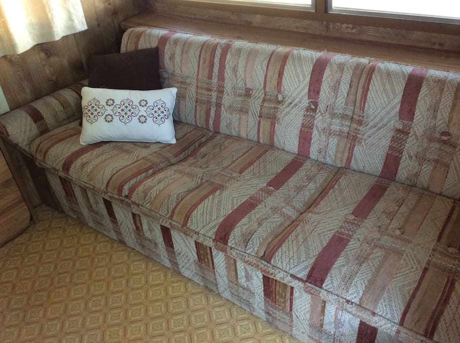 Sitting area with fold down sofa for additional guest