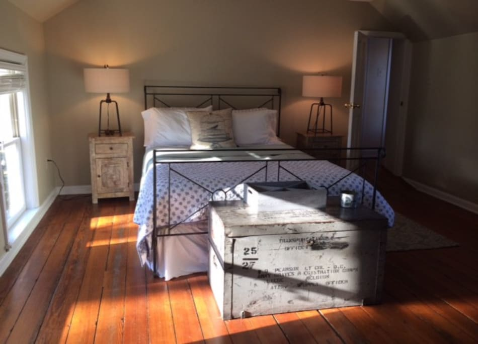 Sunlight cascades into the master bedroom, part of the first rear wing expansion to the original 1880 structure.