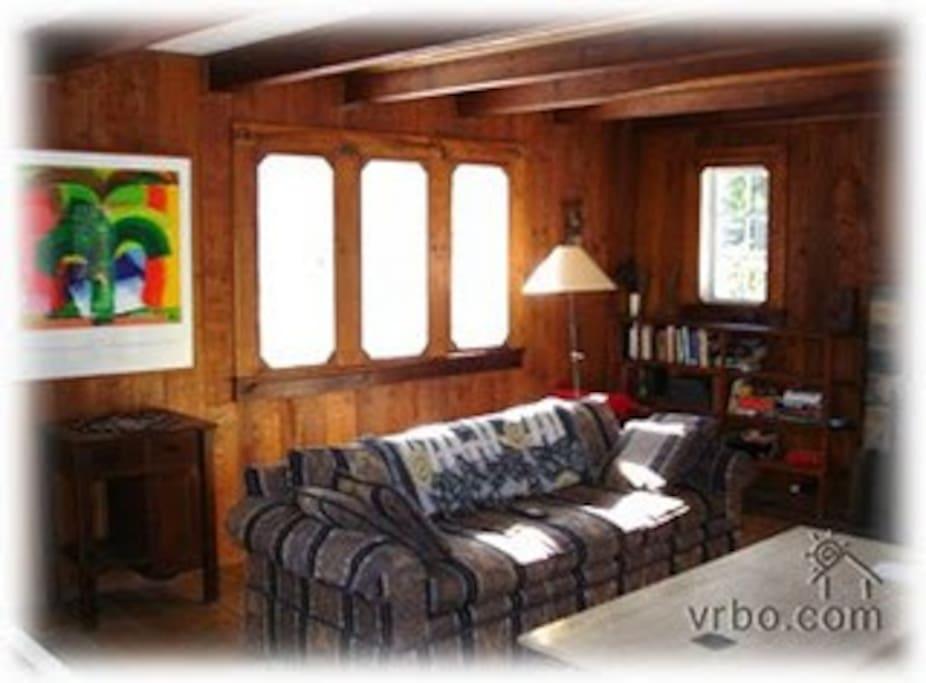 Living room with fire place, piano, lots of books and games. Cable TV.