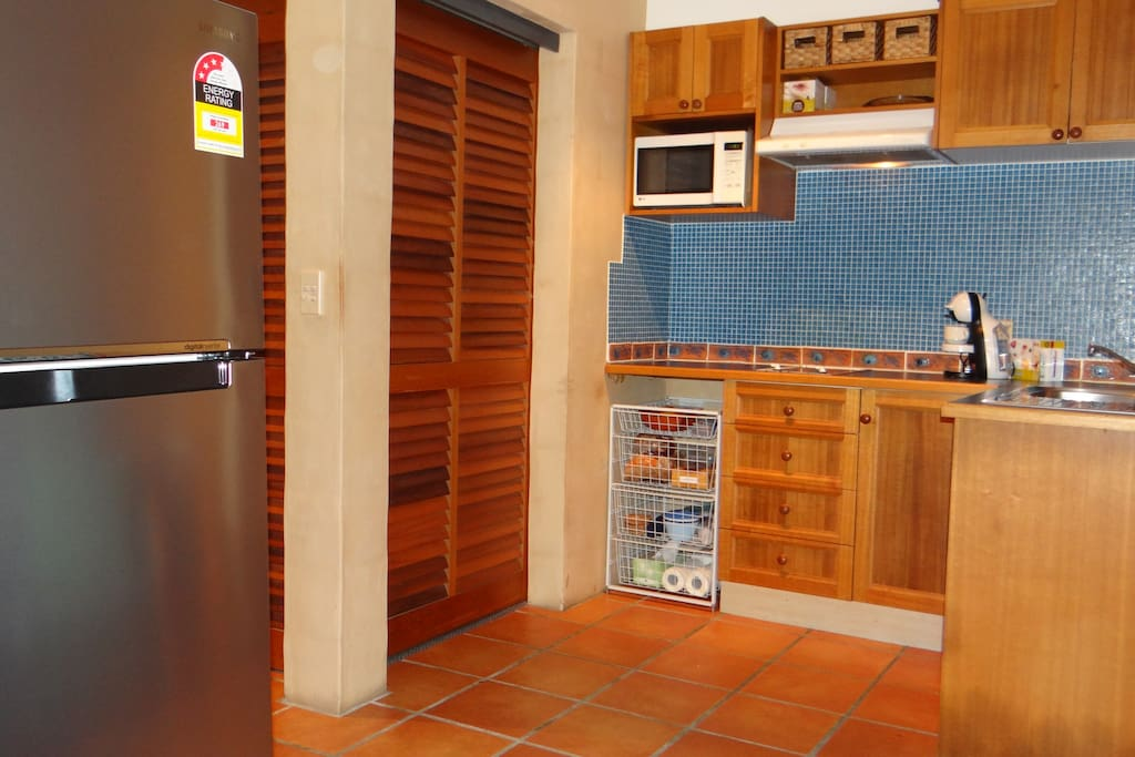 Great large New Fridge in an open plan Kitchen which opens to its private balcony views to Pool and Award winning garden