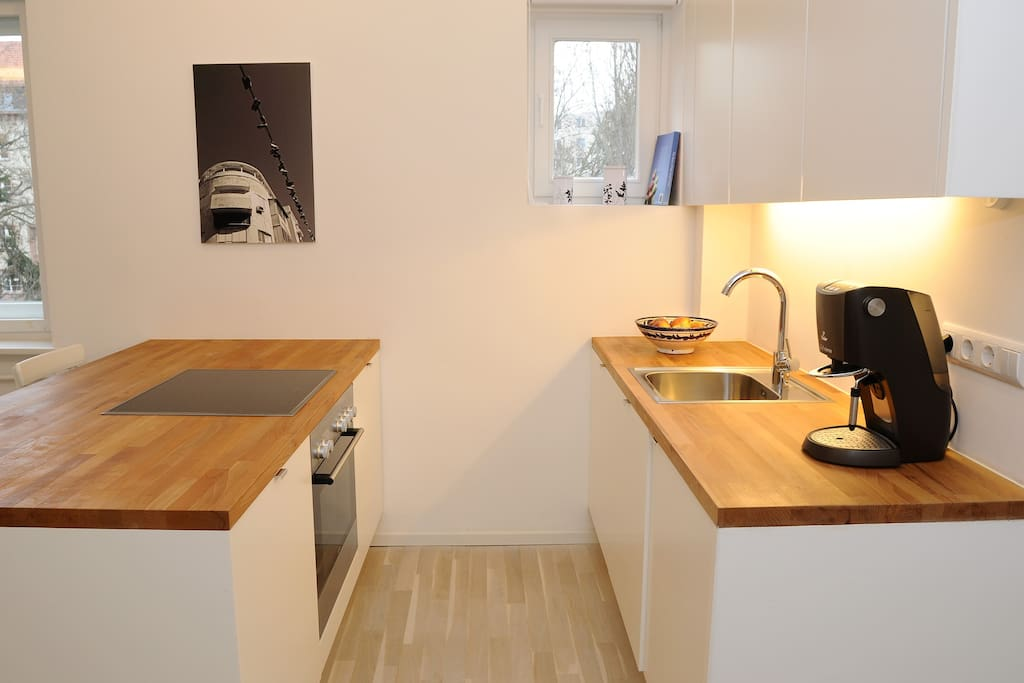 Modern open kitchen with all facilities and a great coffee maker