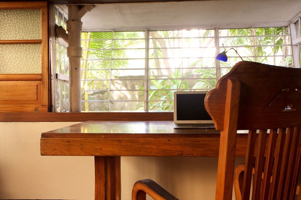 The Guest Room has a narra hardwood desk and chair, looking out to the west garden.