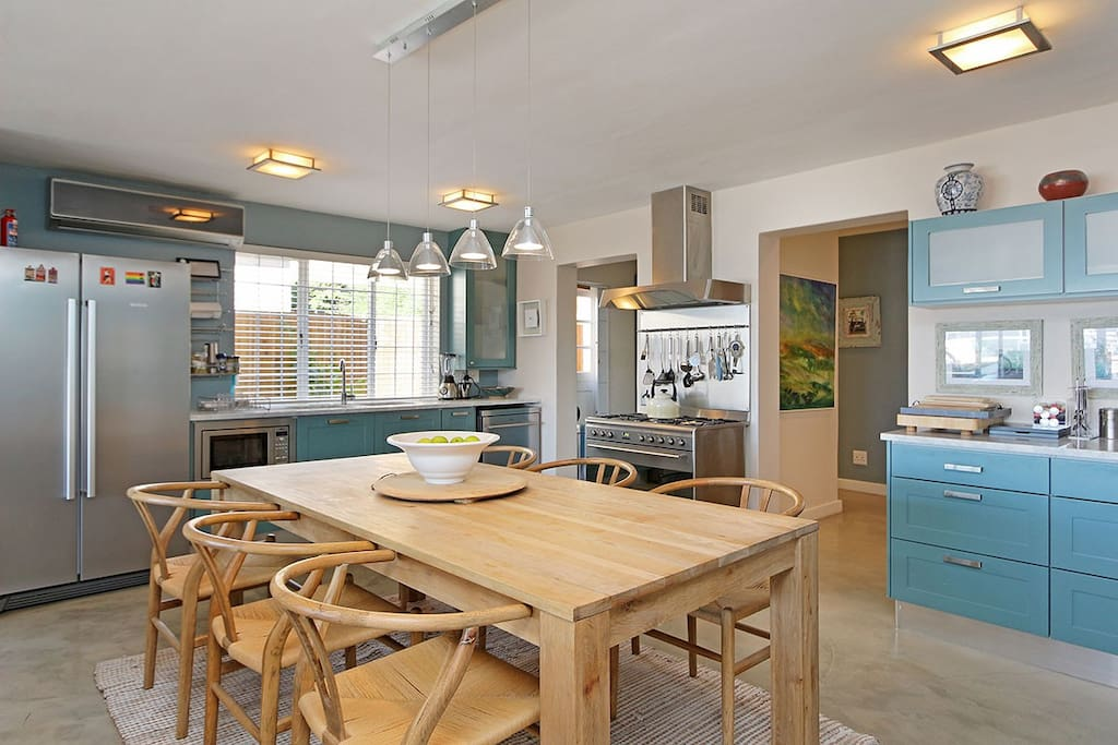 Open plan kitchen and dining area with aircon