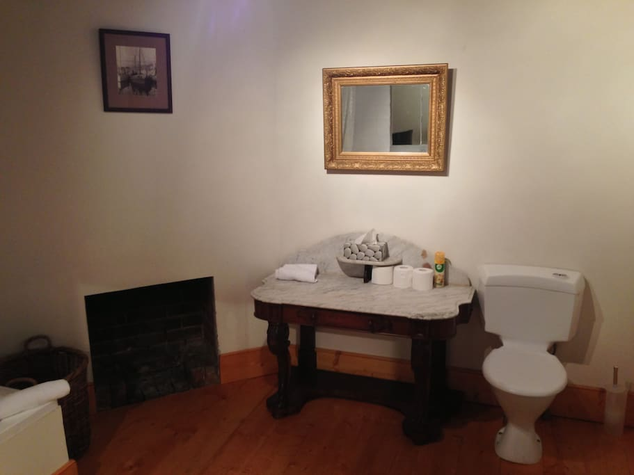 Bathroom with antique washstand.