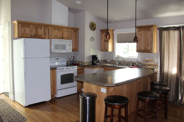 Refrigerator, Microwave and range/oven.  Double sink.  Coffee maker, toaster, pots and pans, plates, cups, coffee mugs, spices, griddle.