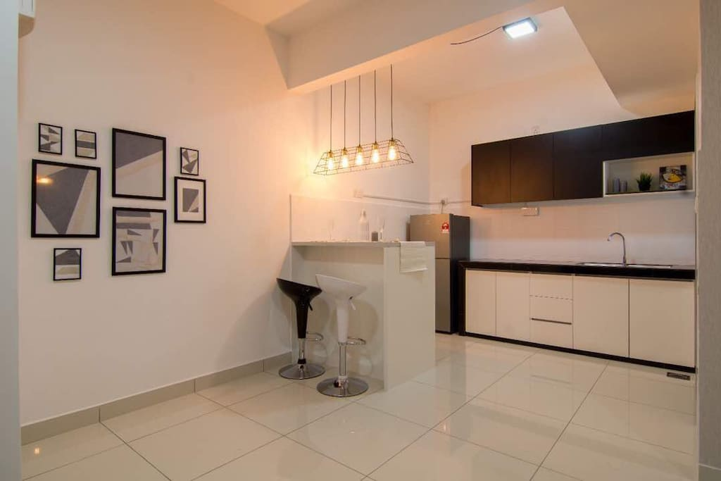 dry kitchen with wash basin. island table and high stool