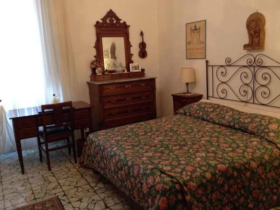 Bedroom 1 with window facing the Mediterranean Sea