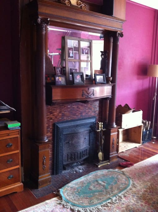 Original details and working fireplace in living room.