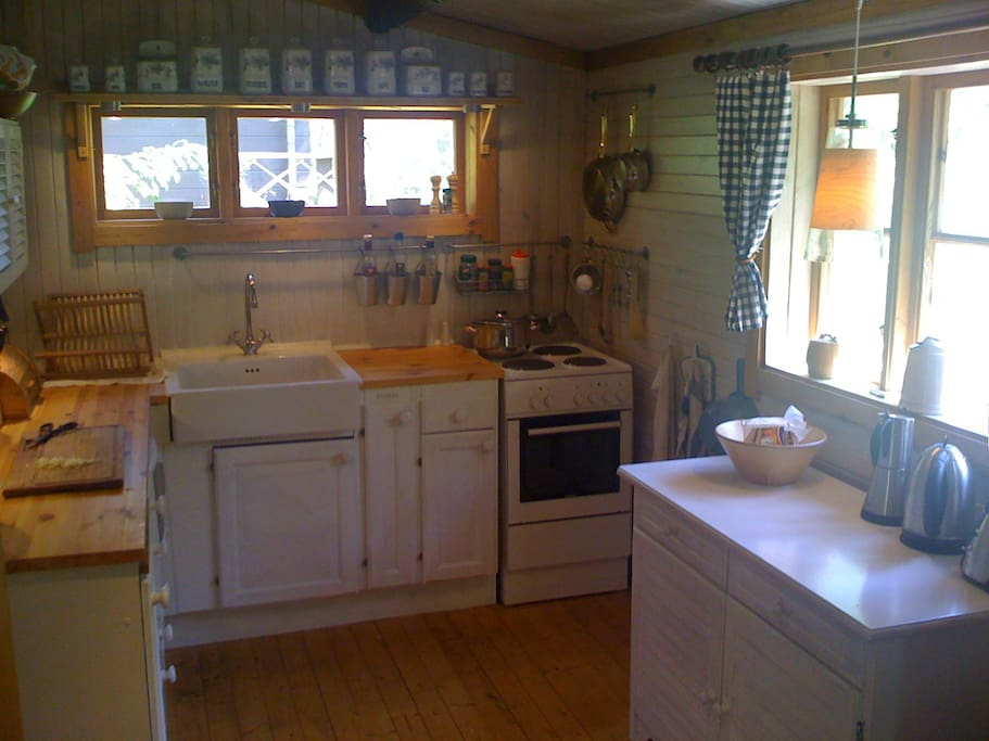Kitchen with fridge, freezer, microwave oven, electric oven/stove.