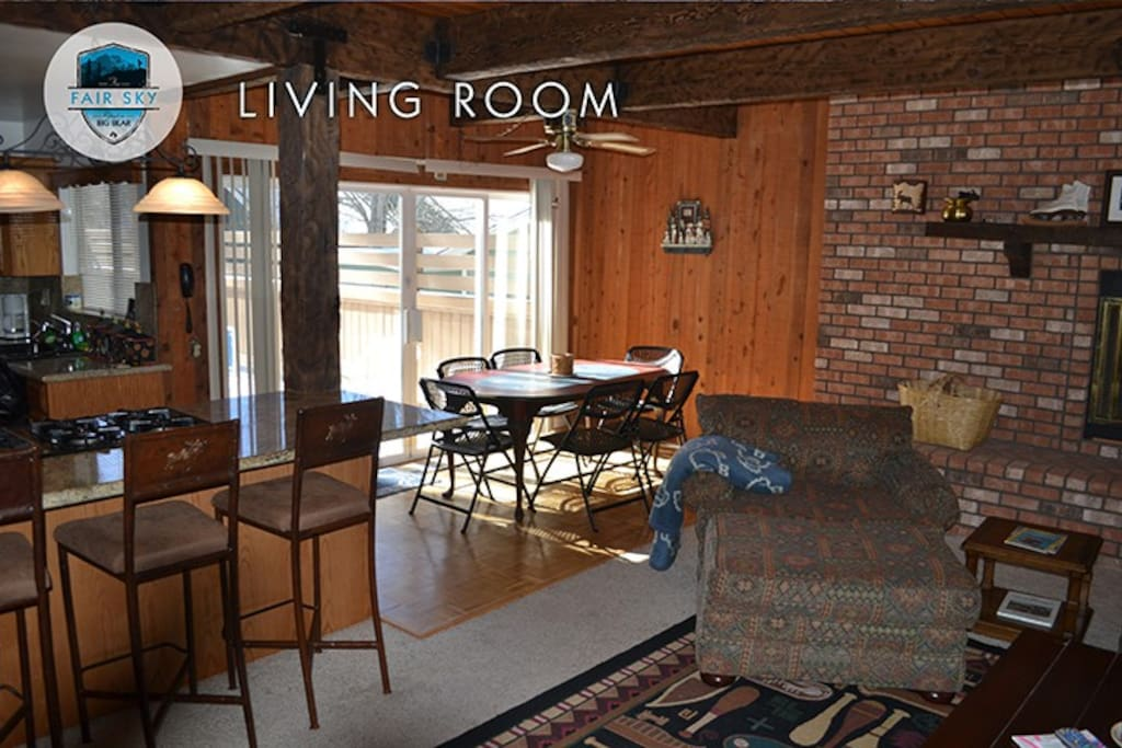 Open concept to kitchen and Dining area opens onto large back deck with jacuzzi and patio furniture
