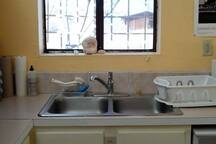 Kitchen sink, and view from window, winter