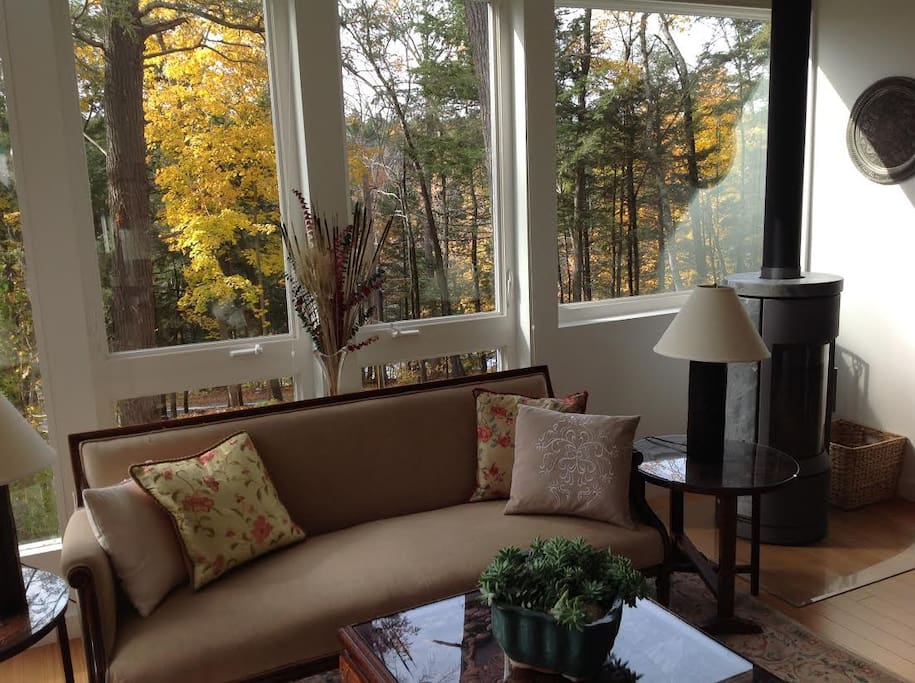 Windows with views of wildlife, trees, boulders and Housatonic River.
