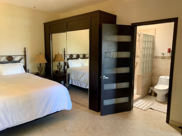 Bedroom with direct access to bathroom.