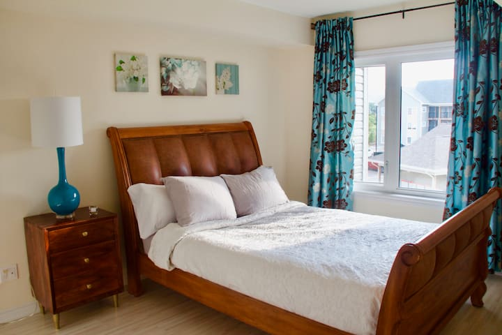 Master bedroom with a queen size bed is located on the first floor.