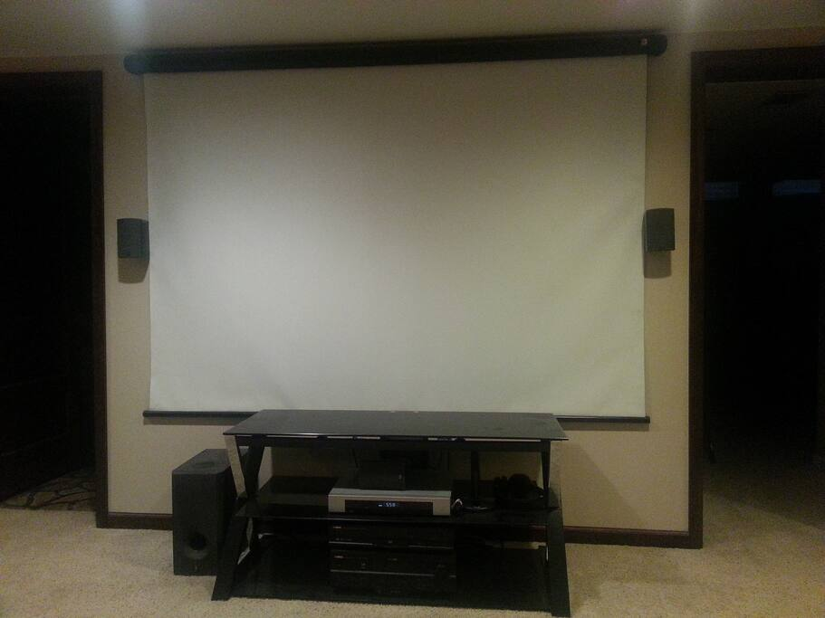 Need entertained?  You're covered.  With a 5.1 surround, digital cable, and a huge projector screen, you be engrossed in entertainment nirvana.